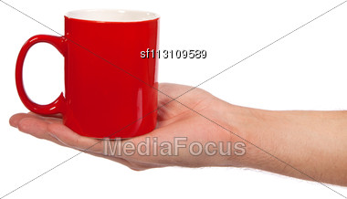 Male Hand Is Holding A Red Cup Isolated On A White Background Stock Photo