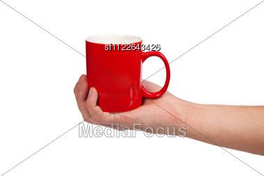 Male Hand Is Holding A Red Cup Stock Photo