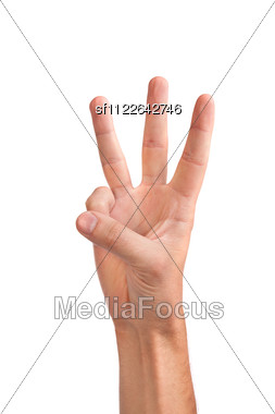 Male Hand Is Showing Three Fingers Stock Photo