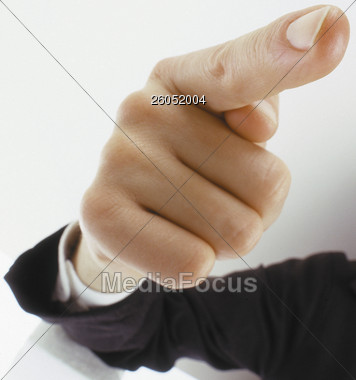 Male Hand Pointing Finger Directly at Viewer Stock Photo