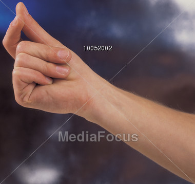 Male Hand Snapping Fingers Stock Photo