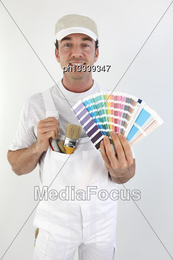 Male Painter Choosing Colours Stock Photo
