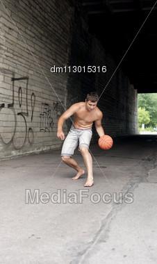 Male Playing Street Basketball Alone Stock Photo
