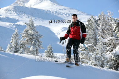 Male Skier On A Mountain Stock Photo