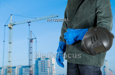 Male Welder Closeup With Welding Equipment On Building Background Stock Photo