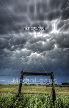 Mammatus Bubble Storm Clouds Saskatchewan With Fence Stock Photo