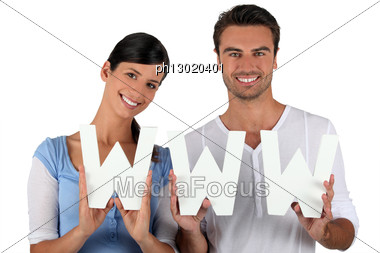 Man And Woman Holding Letters Stock Photo