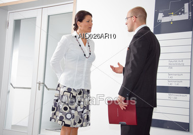 Man And Woman Talking In The Office Stock Photo