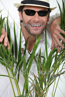 Man Between A Plat Stock Photo