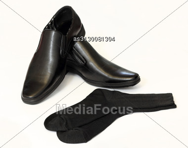 Man's Black Shoes And Socks Stock Photo