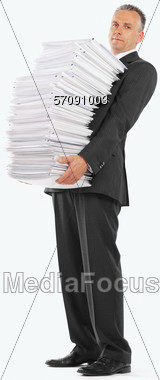 Man Carrying Huge Stack of Papers Stock Photo