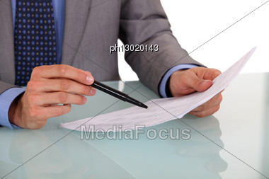 Man Checking Document Before Signing Stock Photo