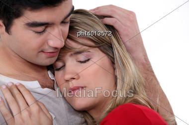 Man Comforting Girlfriend Stock Photo