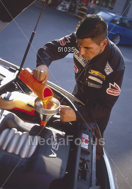 Man Doing Car Oil Change Stock Photo