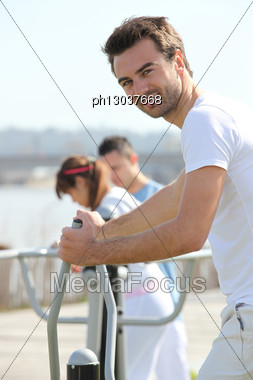 Man Doing Gymnastics In Urban Space Stock Photo