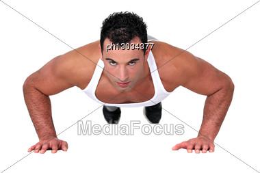 Man Doing Push-up Stock Photo