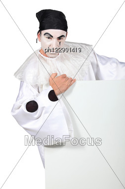 Man Dressed As Clown Holding Message Board Stock Photo
