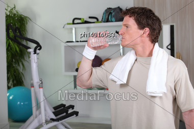Man Drinking Water After Tough Gym Session Stock Photo