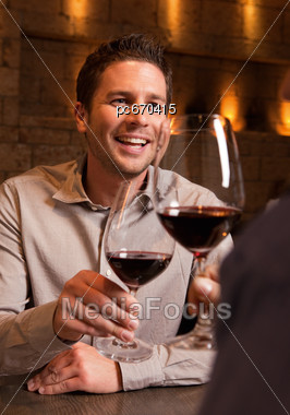 Man Drinking Wine With A Friend Stock Photo