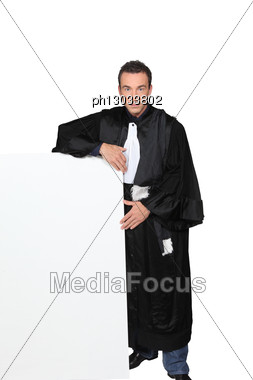 Man In Fancy Dress Holding Message Board Stock Photo