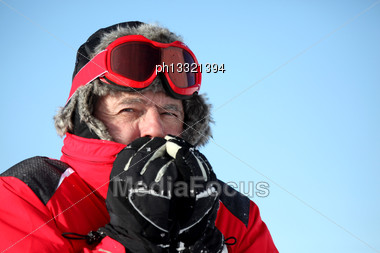 Man Feeling Cold On A Winter's Day Stock Photo