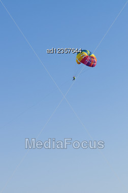 Man Flies To Parachute In The Sky Stock Photo