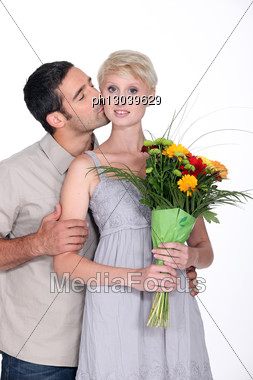 Man Giving Flowers To Wife Stock Photo