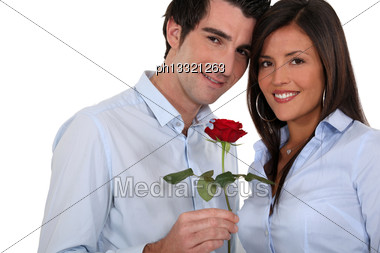 Man Giving Rose To Woman Stock Photo