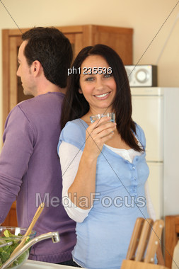 Man And Happy Woman Holding Glass Of Water Stock Photo