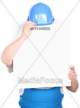 Man In A Hard Hat With A Board Left Blank For Your Message Stock Photo