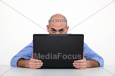 Man Hiding Behind Laptop Stock Photo
