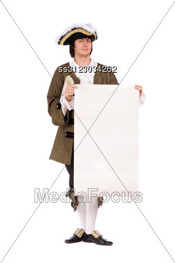Man In A Historical Costume With The Blank Paper In Hands. Stock Photo