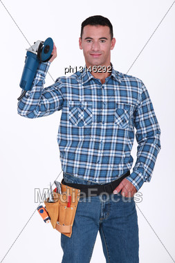 Man Holding An Angle Grinder Stock Photo