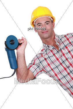 Man Holding Angle Grinder In One Hand Stock Photo