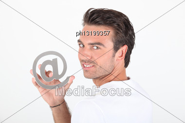 Man Holding At Symbol Stock Photo
