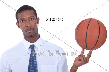 Man Holding Basketball Stock Photo