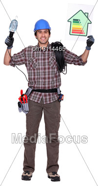 Man Holding Energy Efficiency Panel Stock Photo