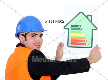 Man Holding Energy Rating Card Stock Photo