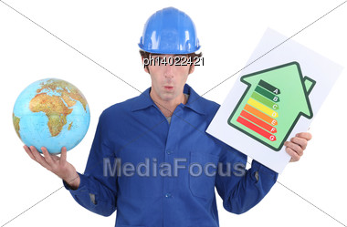 Man Holding Energy Rating Poster And Globe Stock Photo