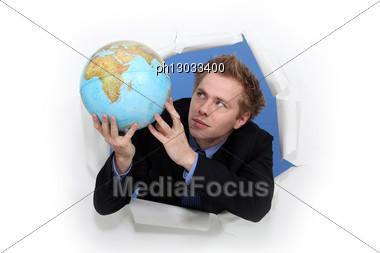 Man Holding Globe Stock Photo
