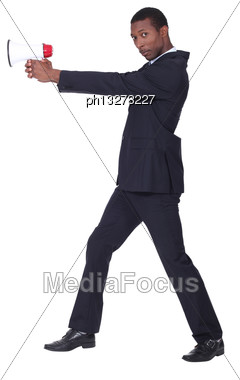 Man Holding Loud Speaker Stock Photo