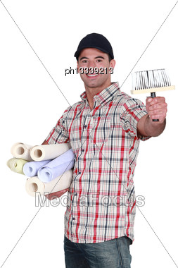 Man Holding Rolls Of Wallpaper Stock Photo