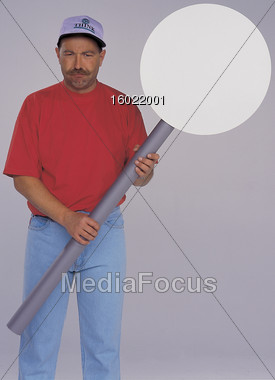 Man Holding Sign Stock Photo