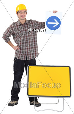 Man Holding Traffic Sign Stock Photo