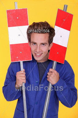 Man Holding Two Metal Road Signs Stock Photo