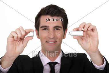 Man Holding USB Memory Stick Stock Photo