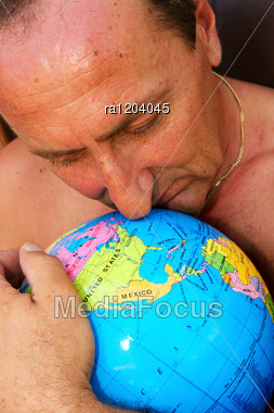 Man Hugging The Globe Vertical Picture. Stock Photo