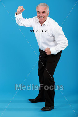 Man In A Suit Dancing Stock Photo
