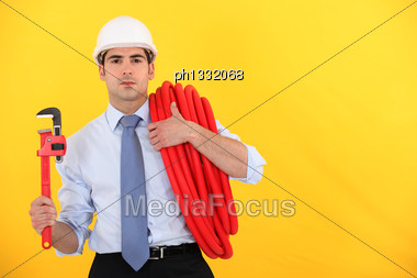 Man In A Suit With Plans Stock Photo
