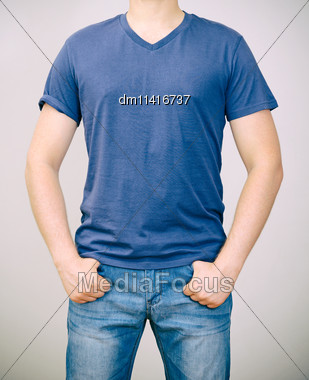 Man In Blue T-shirt. Grey Background Stock Photo